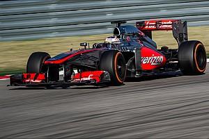 McLaren drivers on their final race of 2013 at Brazil