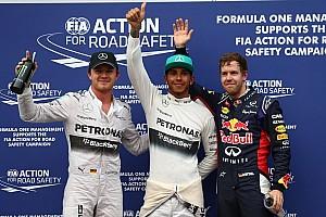 Hamilton grabs pole in soaking Sepang qualifying