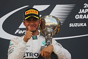 Japanese GP: Hamilton squeezes out Rosberg to score eighth win of 2015