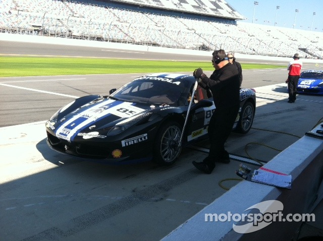 Dave Cortez torques the left front wheel on John Farano's Ferrari Challenge 458 Italia GT