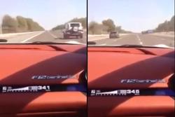 Screen capture of Sebastian Vettel driving Ferrari F12 in Abu Dhabi