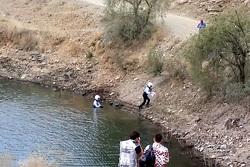 Ott Tanak and co-driver Raigo Molder emerge from a lake