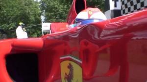Scuderia Ferrari driver Marc Gené tackles the Goodwood hillclimb